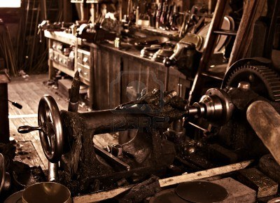 An old busy and cluttered workshop in russet